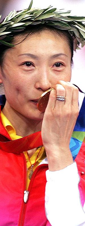 迟到的金牌保住了中国羽毛球队最后的颜面(图)