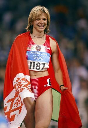 图文:女子百米决赛 内斯特伦科获胜后面露笑容