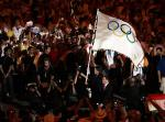 图文:奥运会闭幕式 王岐山入场