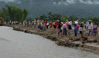 9月13日,云南省德宏傣族景颇族自-云南德宏灾区群众生产自救图片