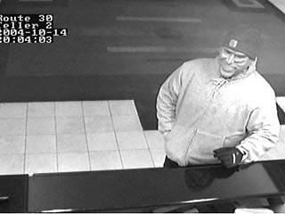 美国一男子戴布什面具成功抢劫一家银行(图)