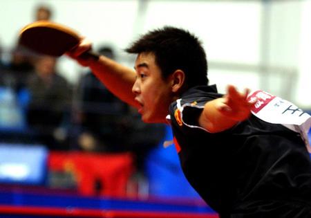 行的2004年世界杯乒乓球小组赛第二轮的比赛中,以4比3的比分险胜