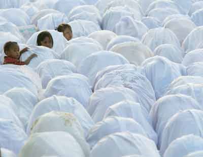 Muslims pray during the Muslim holiday of Eid al- Adha or day of