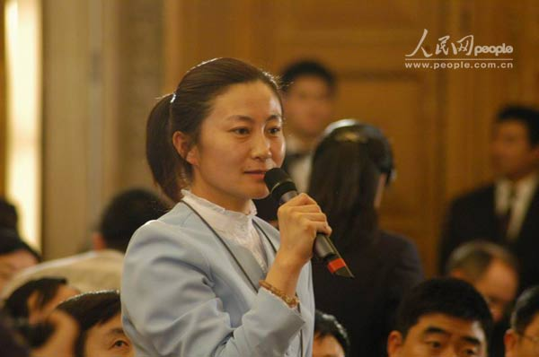 人民日报社记者提问(图)