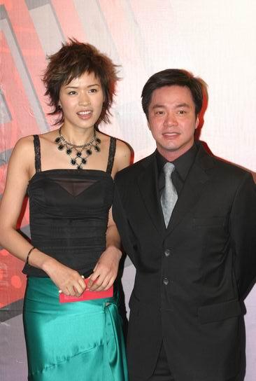 图文:第24届香港金像奖--唐季礼与女伴合影